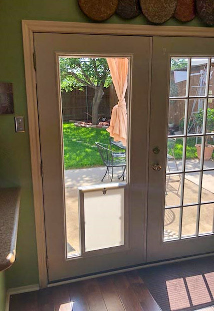 pet door inside french door glass
