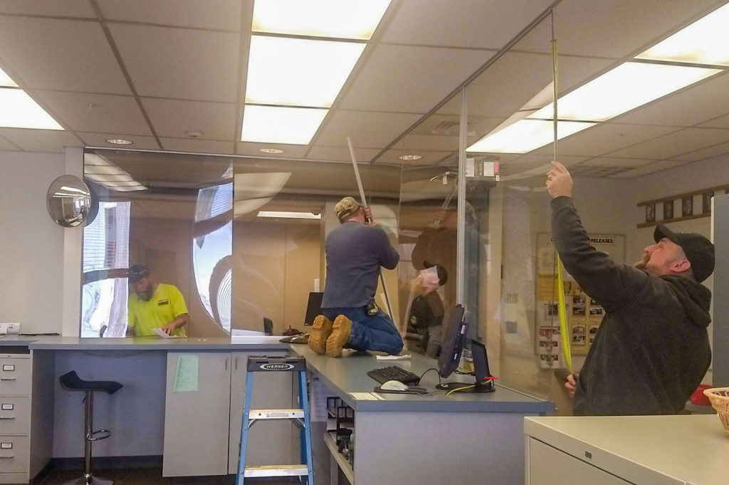 Smith Glass Installing Health Guards